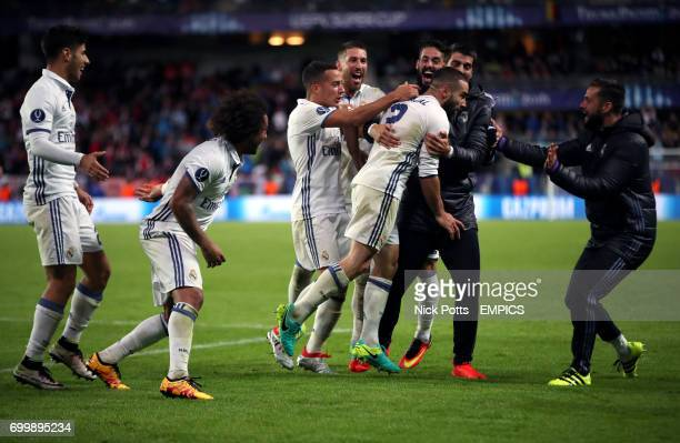 Real Madrid's Daniel Carvajal celebrates scoring his side's third goal of the game with his teammates