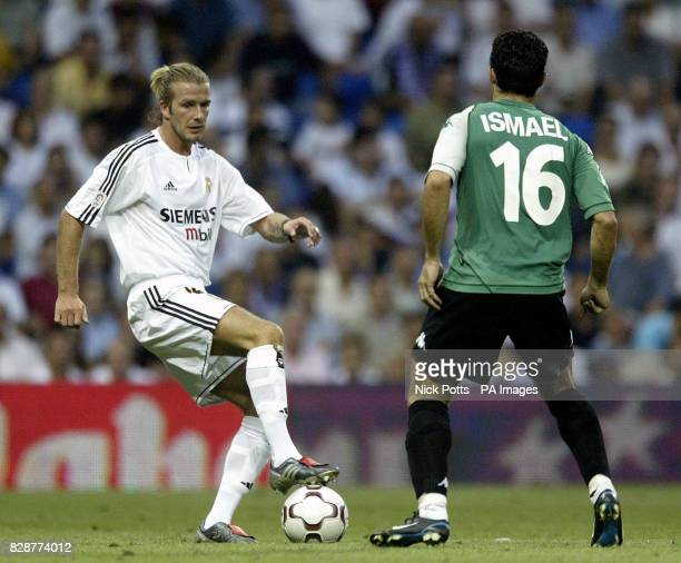 Real Madrid's David Beckham holds the ball away from Real Betis' Ismael during his league debut for Real Madrid in their first game of the Spanish...
