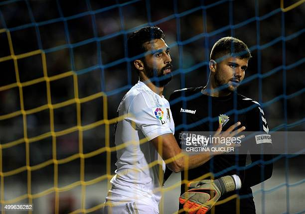 Real Madrid's defender Alvaro Arbeloa touches Cadiz's goalkeeper Pol Balleste during the Spanish Copa del Rey football match Cadiz CF vs Real Madrid...