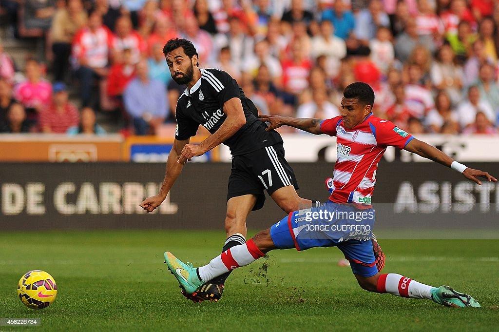 Real Madrid's defender Alvaro Arbeloa vies for the ball Granada's Colombian forward Jeison Murillo during the Spanish league football match Granada...
