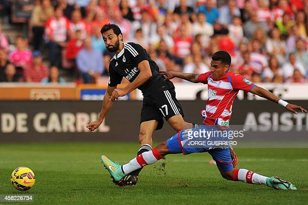 Real Madrid's defender Alvaro Arbeloa vies for the ball Granada's Colombian forward Jeison Murillo during the Spanish league football match Granada...
