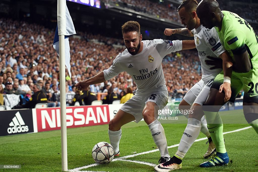 Real Madrid's defender Dani Carvajal (L) and Real Madrid's forward Jese Rodriguez (C) vies with Manchester City's French defender Eliaquim Mangala during the UEFA Champions League semi-final second leg football match Real Madrid CF vs Manchester City FC at the Santiago Bernabeu stadium in Madrid, on May 4, 2016. / AFP / PAUL