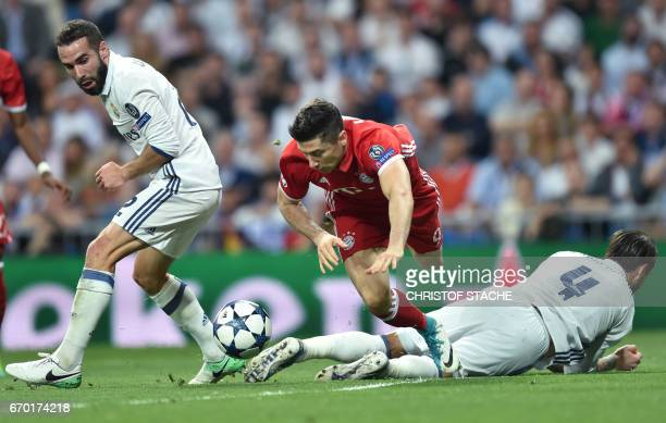 Real Madrid's defender Dani Carvajal Bayern Munich's Polish striker Robert Lewandowski and Real Madrid's defender Sergio Ramos vie for the ball...