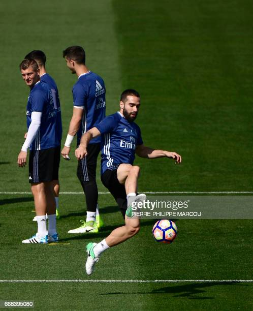 Real Madrid's defender Dani Carvajal controls the ball during a training session at Valdebebas training grounds in Madrid on April 14 2017 on the eve...