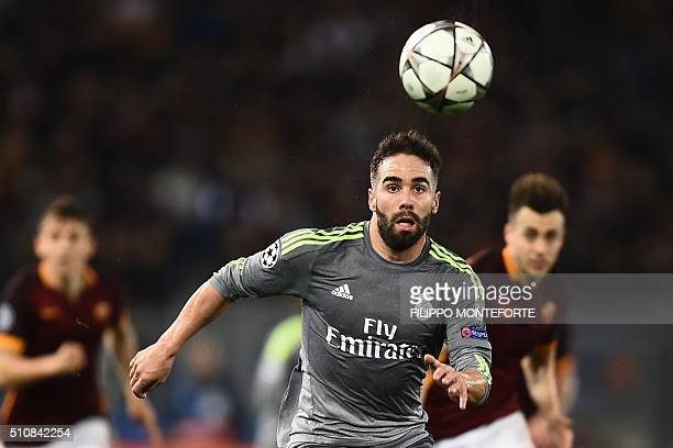Real Madrid's defender Dani Carvajal eyes the ball during the UEFA Champions League football match AS Roma vs Real Madrid on Frebruary 17 2016 at the...