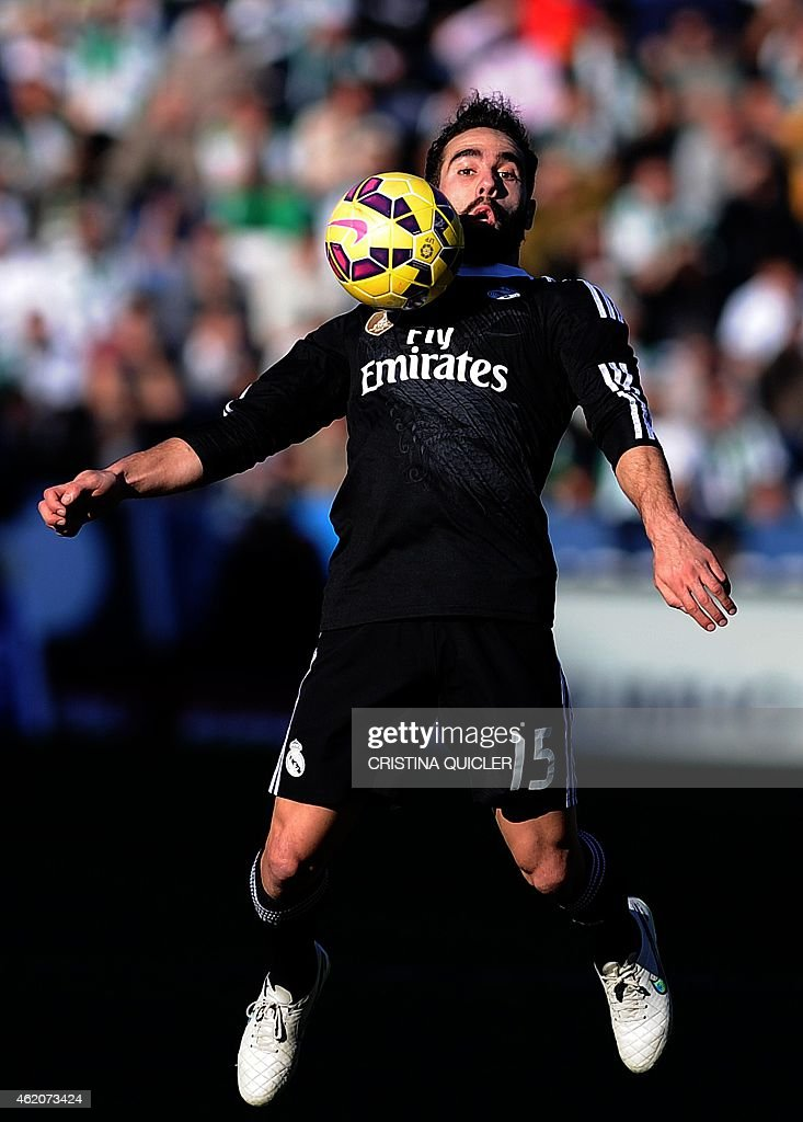 Real Madrid's defender <a gi-track='captionPersonalityLinkClicked' href=/galleries/search?phrase=Dani+Carvajal+-+Spanish+Soccer+Defender&family=editorial&specificpeople=7916431 ng-click='$event.stopPropagation()'>Dani Carvajal</a> jumps up for a ball during the Spanish league football match Cordoba CF vs Real Madrid CF at the Nuevo Arcangel stadium on January 24, 2015.
