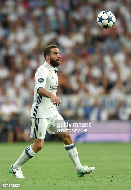 Real Madrid's defender Dani Carvajal plays the ball during the UEFA Champions League quarterfinal second leg football match Real Madrid vs FC Bayern...
