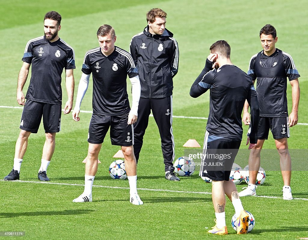 Real Madrid's defender <a gi-track='captionPersonalityLinkClicked' href=/galleries/search?phrase=Dani+Carvajal+-+Spanish+Soccer+Defender&family=editorial&specificpeople=7916431 ng-click='$event.stopPropagation()'>Dani Carvajal</a>, Real Madrid's German midfielder <a gi-track='captionPersonalityLinkClicked' href=/galleries/search?phrase=Toni+Kroos&family=editorial&specificpeople=638597 ng-click='$event.stopPropagation()'>Toni Kroos</a> and Real Madrid's Mexican forward <a gi-track='captionPersonalityLinkClicked' href=/galleries/search?phrase=Javier+Hernandez+-+Soccer+Player&family=editorial&specificpeople=6733186 ng-click='$event.stopPropagation()'>Javier Hernandez</a> 'Chicharito' take part in a training session at Valdebebas training ground in Madrid on April 21, 2015, on the eve of the UEFA Champions League quarter-final secong leg football match Real Madrid CF vs Atletico Madrid.