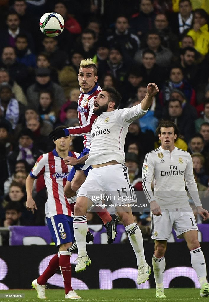 Real Madrid's defender <a gi-track='captionPersonalityLinkClicked' href=/galleries/search?phrase=Dani+Carvajal+-+Spanish+Soccer+Defender&family=editorial&specificpeople=7916431 ng-click='$event.stopPropagation()'>Dani Carvajal</a> (R) vies with Atletico Madrid's French forward <a gi-track='captionPersonalityLinkClicked' href=/galleries/search?phrase=Antoine+Griezmann&family=editorial&specificpeople=7197539 ng-click='$event.stopPropagation()'>Antoine Griezmann</a> during the Spanish Copa del Rey (King's Cup) round of 16 second leg football match Real Madrid CF vs Club Atletico de Madrid at the Santiago Bernabeu stadium in Madrid on January 15, 2015.