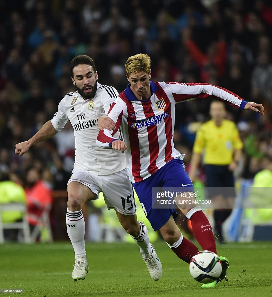 Real Madrid's defender <a gi-track='captionPersonalityLinkClicked' href=/galleries/search?phrase=Dani+Carvajal+-+Spanish+Soccer+Defender&family=editorial&specificpeople=7916431 ng-click='$event.stopPropagation()'>Dani Carvajal</a> (L) vies with Atletico Madrid's forward <a gi-track='captionPersonalityLinkClicked' href=/galleries/search?phrase=Fernando+Torres&family=editorial&specificpeople=194755 ng-click='$event.stopPropagation()'>Fernando Torres</a> during the Spanish Copa del Rey (King's Cup) round of 16 second leg football match Real Madrid CF vs Club Atletico de Madrid at the Santiago Bernabeu stadium in Madrid on January 15, 2015.
