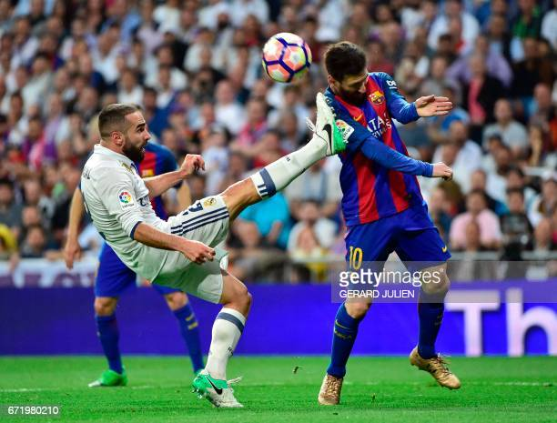 Real Madrid's defender Dani Carvajal vies with Barcelona's Argentinian forward Lionel Messi during the Spanish league football match Real Madrid CF...