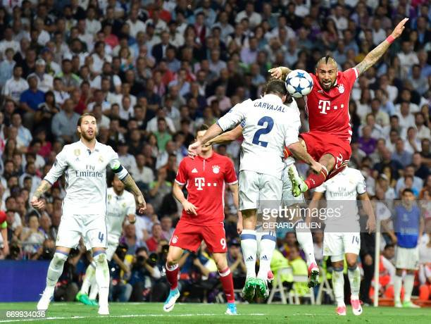 Real Madrid's defender Dani Carvajal vies with Bayern Munich's Chilean midfielder Arturo Vidal during the UEFA Champions League quarterfinal second...