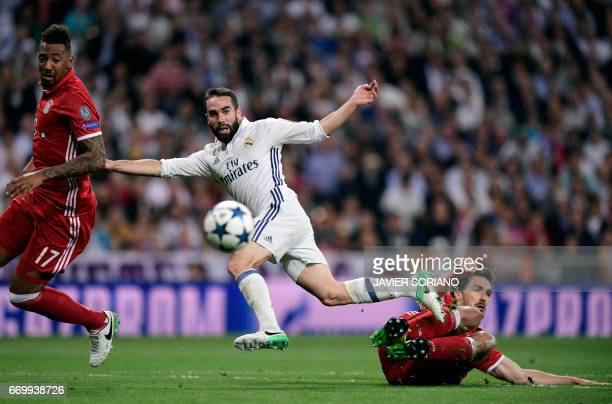 Real Madrid's defender Dani Carvajal vies with Bayern Munich's defender Mats Hummels during the UEFA Champions League quarterfinal second leg...