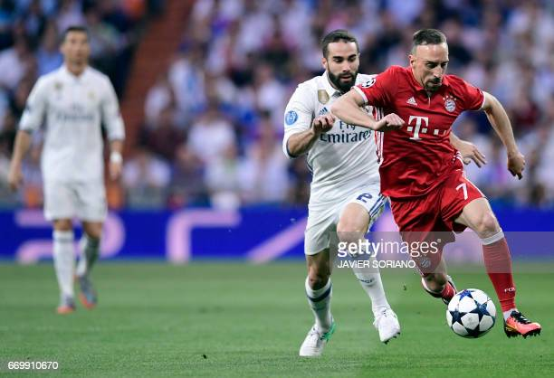 Real Madrid's defender Dani Carvajal vies with Bayern Munich's French midfielder Franck Ribery during the UEFA Champions League quarterfinal second...