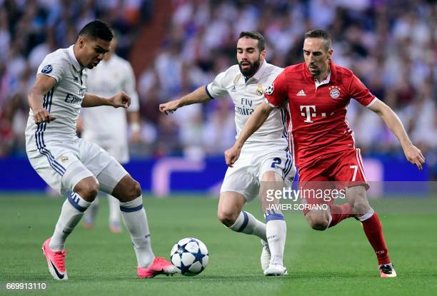 Real Madrid's defender Dani Carvajal vies with Bayern Munich's French midfielder Franck Ribery beside Real Madrid's Brazilian midfielder Casemiro...