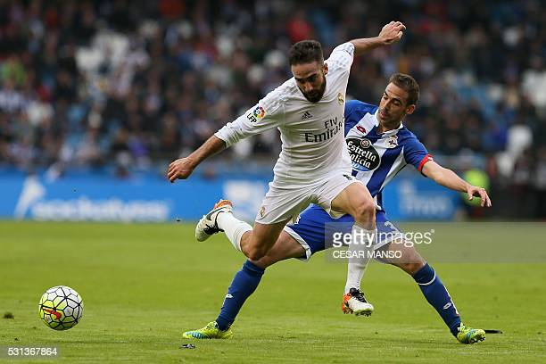 Real Madrid's defender Dani Carvajal vies with Deportivo La Coruna's defender Fernando Navarro during the Spanish league football match RC Deportivo...