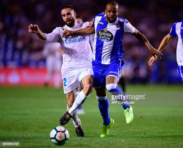 Real Madrid's defender Dani Carvajal vies with Deportivo La Coruna's Brazilian defender Sidnei during the Spanish league footbal match RC Deportivo...