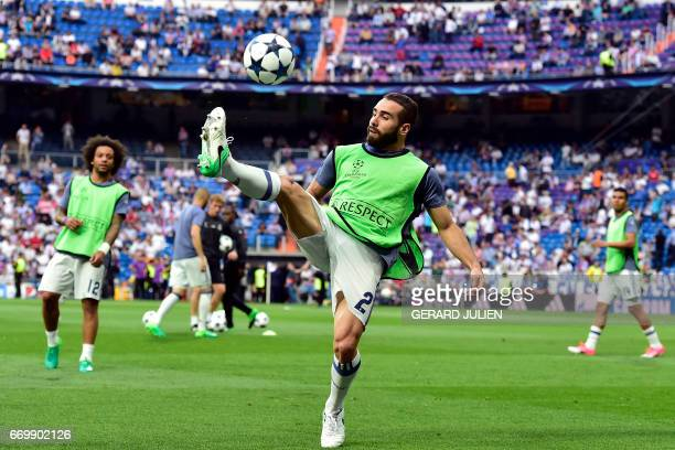 Real Madrid's defender Dani Carvajal warms up before the UEFA Champions League quarterfinal second leg football match Real Madrid vs FC Bayern Munich...