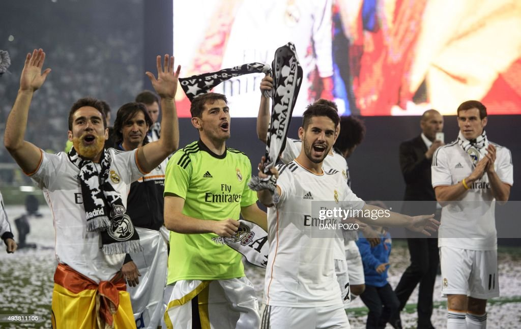 Real Madrid's defender Daniel Carvajal, Real Madrid's goalkeeper Iker Casillas, Real Madrid's midfielder Isco and Real Madrid's Welsh forward Gareth Bale celebrate their Champions League title at the Santiago Bernabeu stadium in Madrid on May 25, 2014, a day after beating Atletico Madrid 4-1 at the Luz stadium in Lisbon, Portugal.