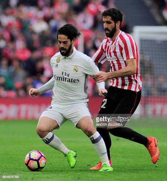 Real Madrid's defender Daniel Carvajal vies with Athletic Bilbao's midfielder Raul Garcia during the Spanish league football match Athletic Club...