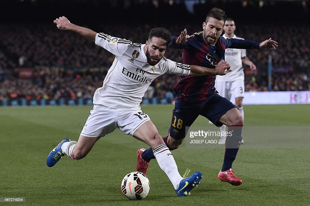 Real Madrid's defender Daniel Carvajal (L) vies with Barcelona's defender <a gi-track='captionPersonalityLinkClicked' href=/galleries/search?phrase=Jordi+Alba&family=editorial&specificpeople=5437949 ng-click='$event.stopPropagation()'>Jordi Alba</a> during the 'clasico' Spanish league football match FC Barcelona vs Real Madrid CF at the Camp Nou stadium in Barcelona on March 22, 2015.