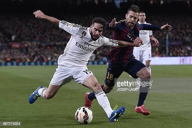 Real Madrid's defender Daniel Carvajal vies with Barcelona's defender Jordi Alba during the 'clasico' Spanish league football match FC Barcelona vs...