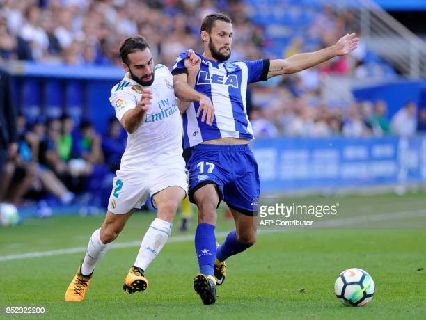 Real Madrid's defender from Spain Daniel Carvajal vies with Alaves' forward from Spain Alfonso Pedraza during the Spanish league football match...