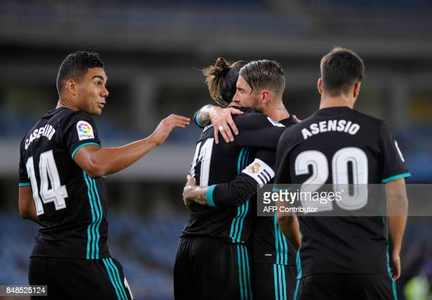 Real Madrid's defender from Spain Sergio Ramos and Real Madrid's midfielder from Brazil Casemiro congratulate Real Madrid's forward from Wales Gareth...