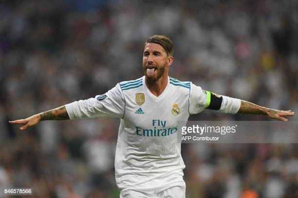 Real Madrid's defender from Spain Sergio Ramos celebrates after scoring during the UEFA Champions League football match Real Madrid CF vs APOEL FC at...