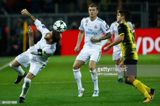 Real Madrid's defender from Spain Sergio Ramos heads the ball during the UEFA Champions League Group H football match BVB Borussia Dortmund v Real...