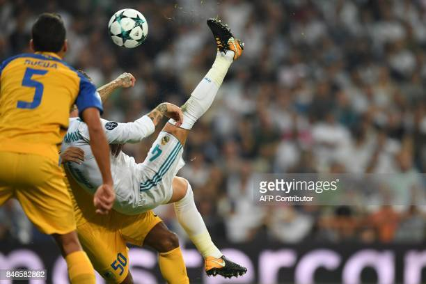 Real Madrid's defender from Spain Sergio Ramos kicks the ball during the UEFA Champions League football match Real Madrid CF vs APOEL FC at the...