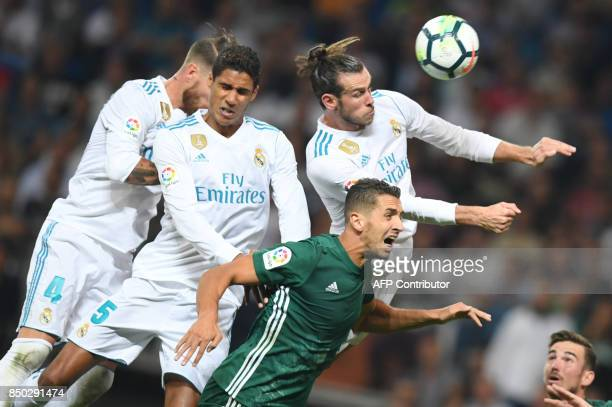Real Madrid's defender from Spain Sergio Ramos Real Madrid's defender from France Raphael Varane and Real Madrid's forward from Wales Gareth Bale vie...