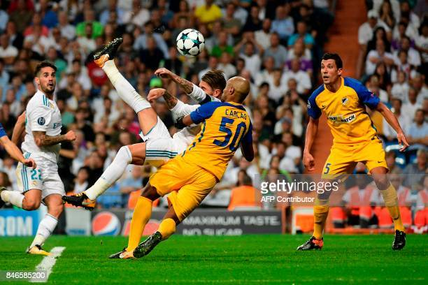 Real Madrid's defender from Spain Sergio Ramos scores during the UEFA Champions League football match Real Madrid CF vs APOEL FC at the Santiago...