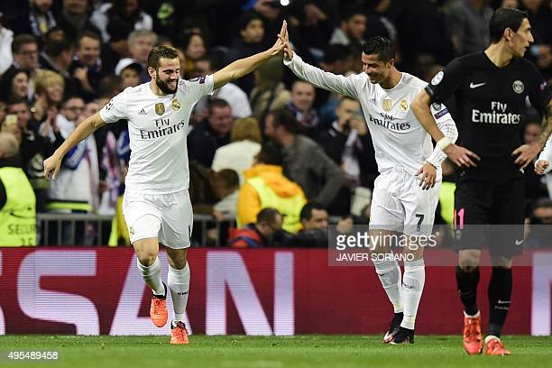 Real Madrid's defender Nacho Fernandez and Real Madrid's Portuguese forward Cristiano Ronaldo celebrate after scoring a goal during the UEFA...