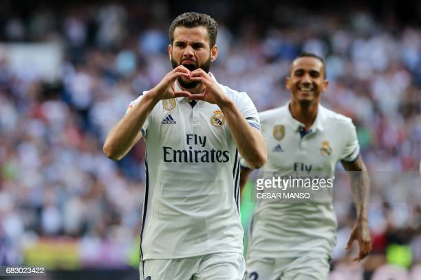 Real Madrid's defender Nacho Fernandez celebrates a goal during the Spanish league football match Real Madrid CF vs Sevilla FC at the Santiago...