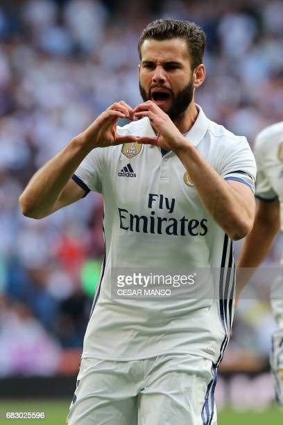 Real Madrid's defender Nacho Fernandez celebrates a goal during the Spanish league football match Real Madrid CF vs Sevilla FC at the Santiago...