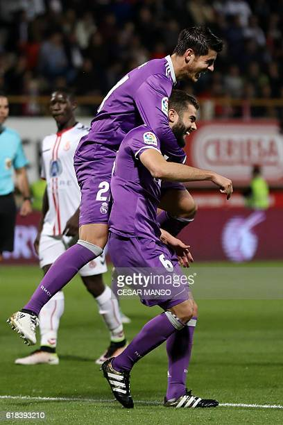 Real Madrid's defender Nacho Fernandez celebrates a goal with Real Madrid's forward Alvaro Morata during the Spanish Copa del Rey round of 32 first...