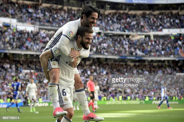 Real Madrid's defender Nacho Fernandez celebrates a goal with Real Madrid's midfielder Isco during the Spanish league football match Real Madrid CF...