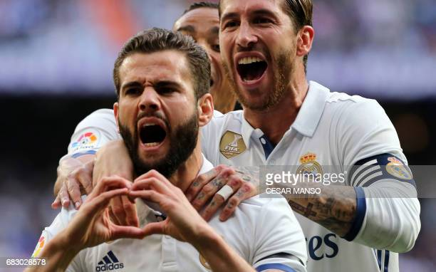 Real Madrid's defender Nacho Fernandez celebrates a goal with Real Madrid's defender Sergio Ramos during the Spanish league football match Real...