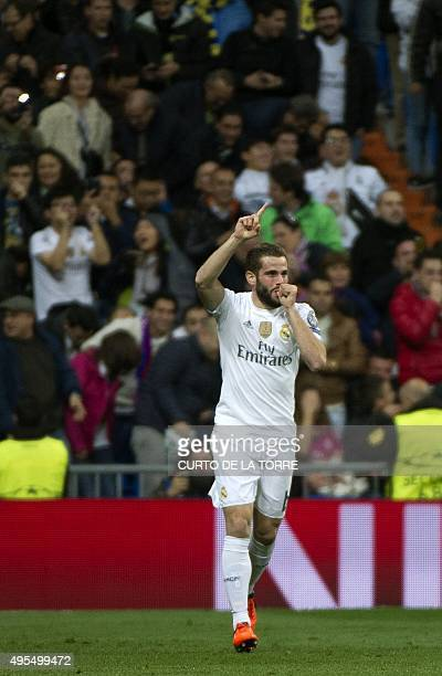 Real Madrid's defender Nacho Fernandez celebrates his goal during the UEFA Champions League group stage football match Real Madrid CF vs Paris...