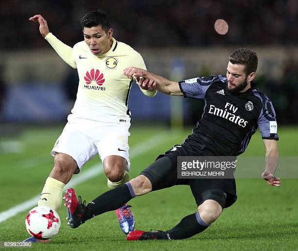 Real Madrid's defender Nacho Fernandez fights for the ball with Club America's forward Silvio Romero during the Club World Cup semifinal football...