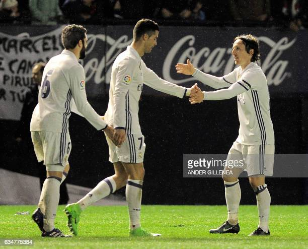 Real Madrid's defender Nacho Fernandez Portuguese forward Cristiano Ronaldo and Croatian midfielder Luka Modric celebrate after forward Lucas Vazquez...