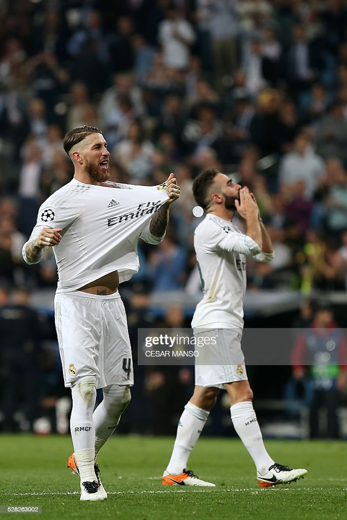 Real Madrid's defender Sergio Ramos (L) and Real Madrid's defender Dani Carvajal celebrate their victory at the end the UEFA Champions League semi-final second leg football match Real Madrid CF vs Manchester City FC at the Santiago Bernabeu stadium in Madrid, on May 4, 2016. Real Madrid won 1-0 / AFP / CESAR