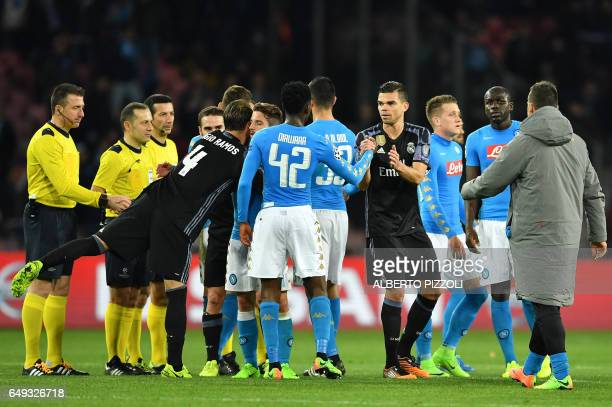 Real Madrid's defender Sergio Ramos and Real Madrid's Portuguese defender Pepe shake hands with Napoli's forward from Belgium Dries Mertens and...