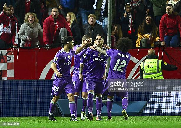 Real Madrid's defender Sergio Ramos ceebrates with teammate after scoring a goal during the Spanish Copa del Rey round of 16 second leg football...