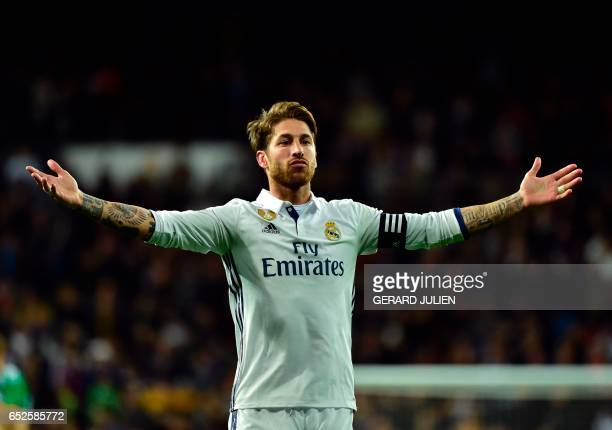 Real Madrid's defender Sergio Ramos celebrates after scoring a goal during the Spanish league footbal match Real Madrid CF vs Real Betis at the...