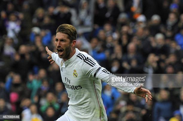 Real Madrid's defender Sergio Ramos celebrates after scoring during the Spanish league football match Real Madrid CF vs Real Sociedad de Futbol at...