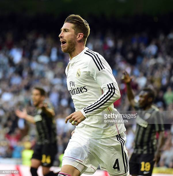 Real Madrid's defender Sergio Ramos celebrates after scoring during the Spanish league football match Real Madrid CF vs Malaga FC at the Santiago...