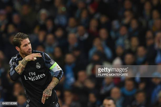 TOPSHOT Real Madrid's defender Sergio Ramos celebrates after scoring during the UEFA Champions League football match SSC Napoli vs Real Madrid on...