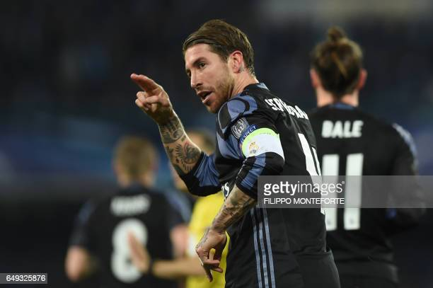 Real Madrid's defender Sergio Ramos celebrates after scoring during the UEFA Champions League football match SSC Napoli vs Real Madrid on March 7...